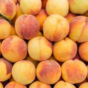 Fresh ripe peaches background