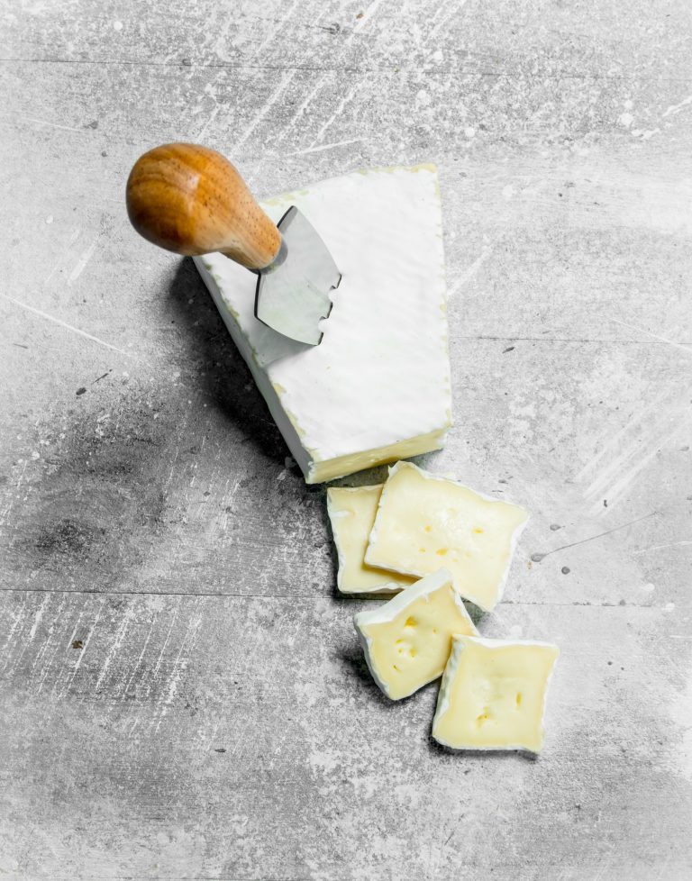 Brie cheese with knife.